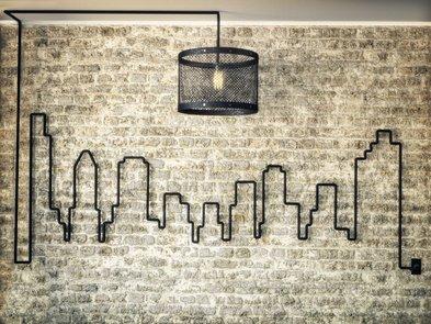 Kabel verstecken, Skyline and der Wand, gezeichnet mit einem Stromkabel, Foto: storm / fotolia.de